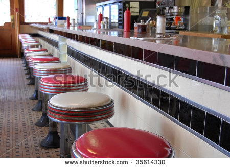 stock-photo-an-old-fashioned-diner-with-a-tile-floor-and-art-deco-style-bar-stools-35614330.jpg