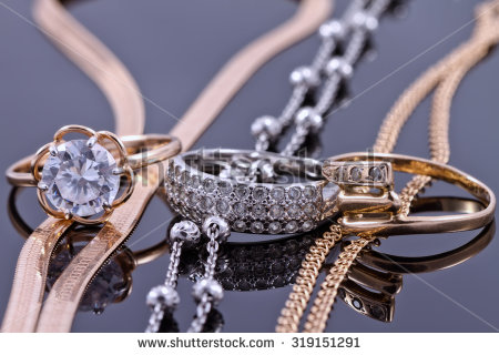 stock-photo-jewelry-sets-of-gold-and-silver-chain-and-ring-319151291.jpg