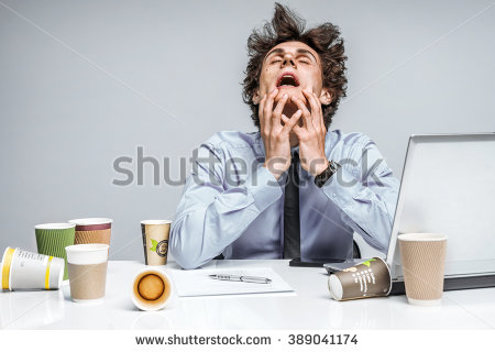 stock-photo-omg-frustrated-man-sitting-desperate-over-paper-work-at-desk-negative-emotion-facial-expression-389041174.jpg