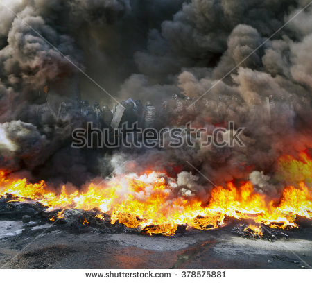 stock-photo-riots-in-the-city-citizens-in-conflict-with-the-power-harness-tires-and-vehicles-police-disperse-378575881
