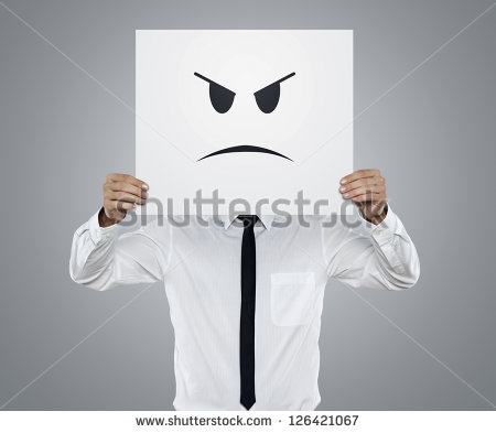 stock-photo-young-businessman-holding-card-with-a-angry-face-on-it-isolated-on-gray-background-126421067