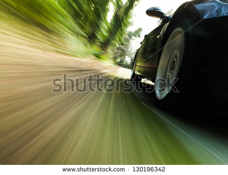 stock-photo-front-side-view-of-black-car-driving-fast-130196342