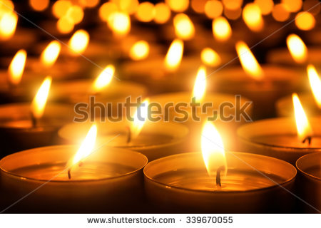 stock-photo-many-candle-flames-glowing-in-the-dark-create-a-spiritual-atmosphere-339670055.jpg