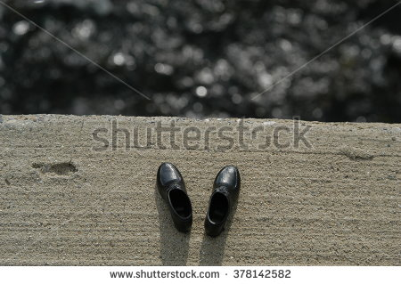 stock-photo-suicide-concept-man-s-shoes-left-on-the-edge-of-a-bridge-with-river-below-378142582