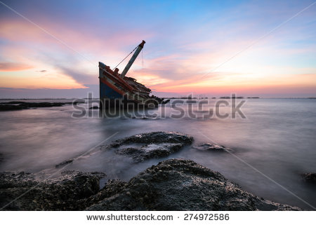stock-photo-shipwreck-or-wrecked-boat-on-beach-274972586