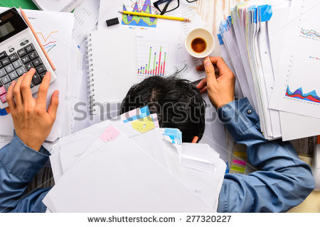 stock-photo-businessman-heavy-workload-sleep-at-office-desk-with-finance-sheet-calculator-and-coffee-concept-277320227.jpg